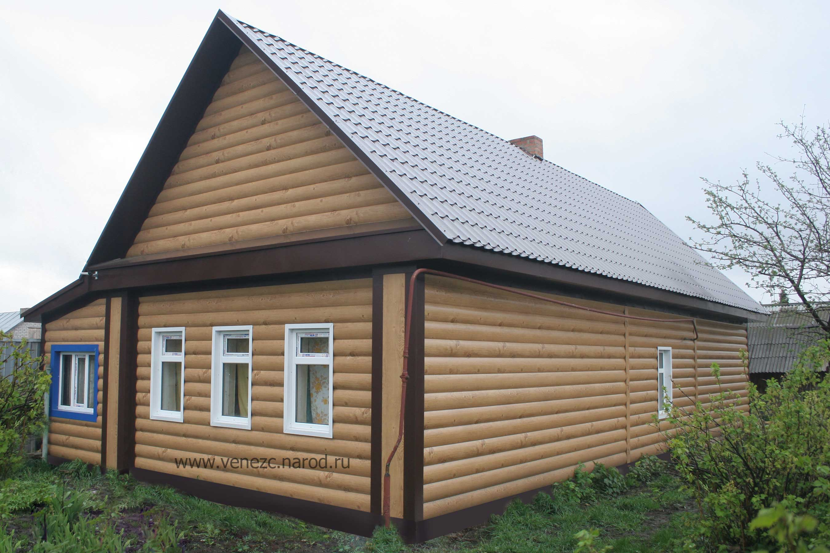 Обшивка деревянного дома сайдингом фото